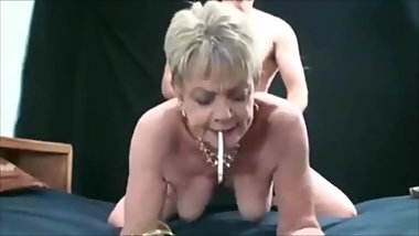 Short hair grandma smoking while is fucked doggystyle