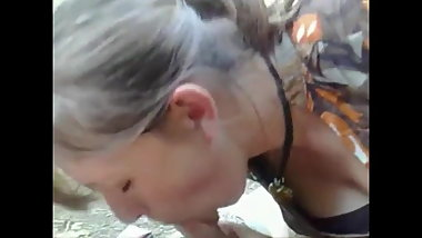 Gorgeous silver-haired MILF gives outdoor blow job