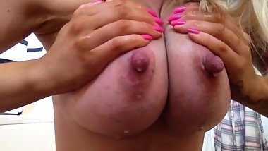 Full engorged leaking milky tits