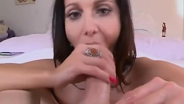 Bigass milf tugging and tittyfucking cock