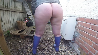 Flashing Outdoors in the Yard in Wellingtons