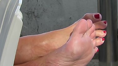 My mature neighbour's candid sweaty soles