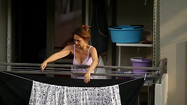 MILF neighbor showing downblouse on the balcony